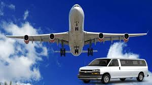 A white airplane on the sky and a white shuttle service car.